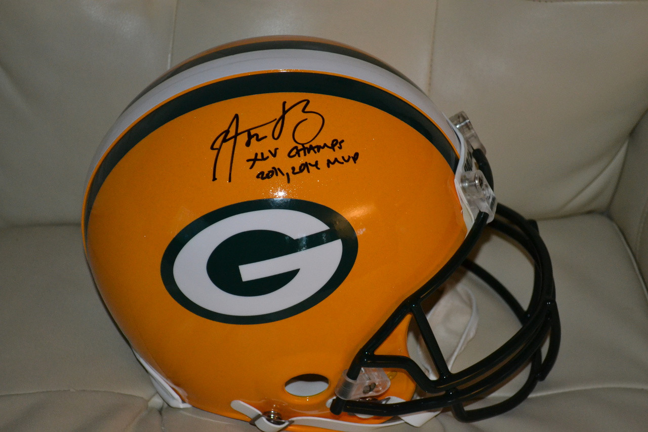 5b9c944bb   RARE  Aaron Rodgers Authentic Autographed Green Bay Packers Proline  Helmet with DOUBLE inscription AND  12! Image 1. Loading zoom