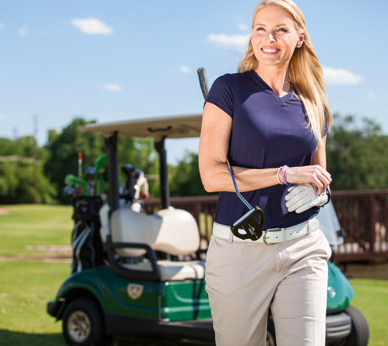Female Golfer Wearing IonThins