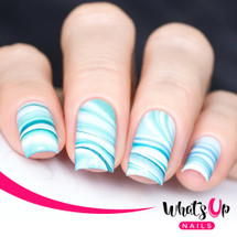 AVAILABLE AT GIRLY BITS COSMETICS www.girlybitscosmetics.com Marble Madness, Blue Water Decals by Whats Up Nails | Photo credit: IG@solo_nails