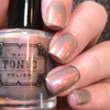 AVAILABLE AT GIRLY BITS COSMETICS www.girlybitscosmetics.com Incandescent (Holiday 2016) by Tonic Polish | Swatch courtesy of @dsetterfield74
