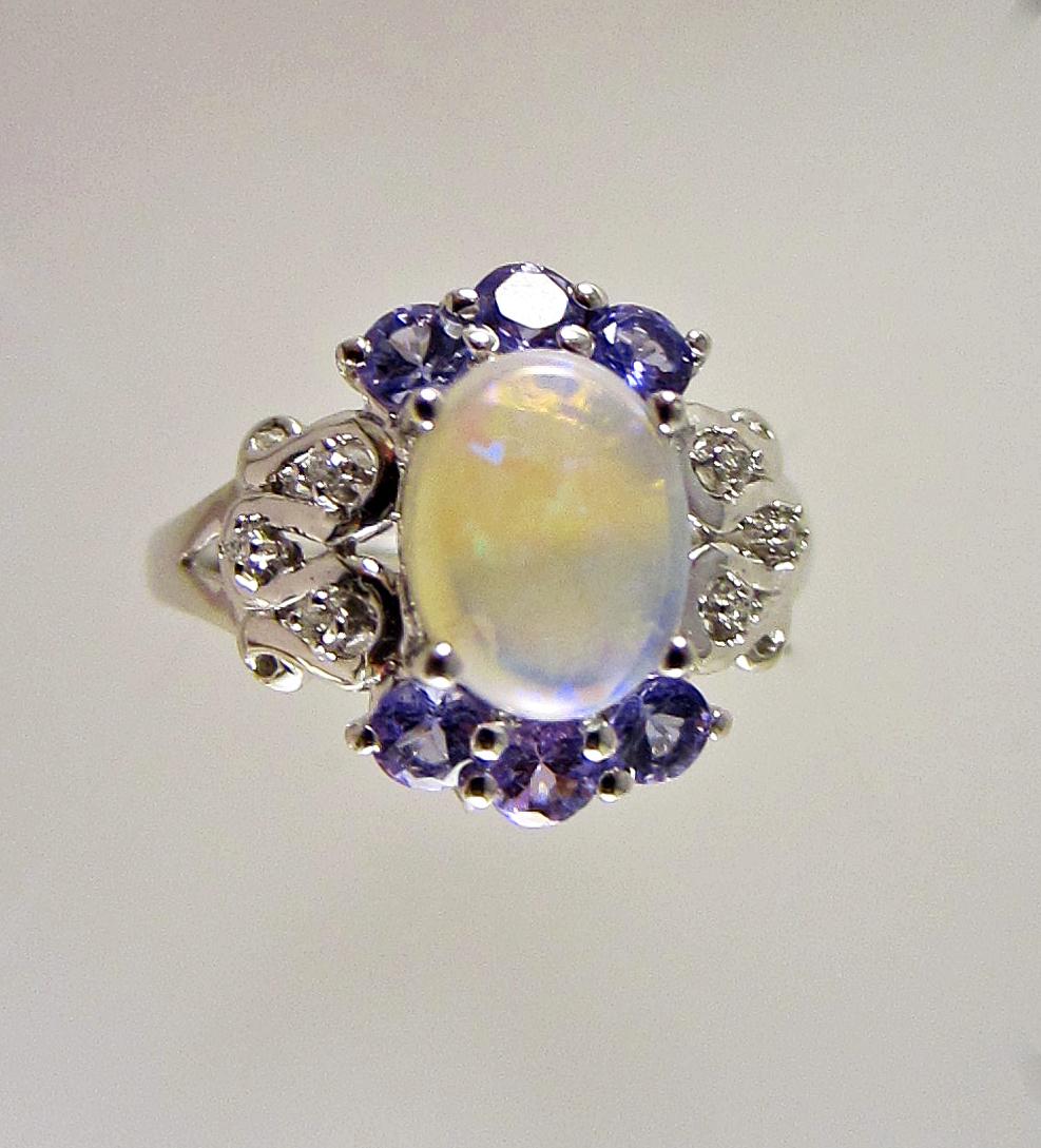 crystal opal, tanzanite, diamond ring