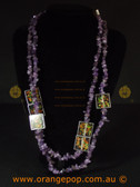 Long purple necklace with abstract detailing