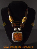 Large square orange toned women's necklace