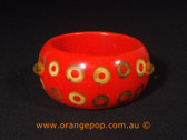 Orange with circle design women's cuff