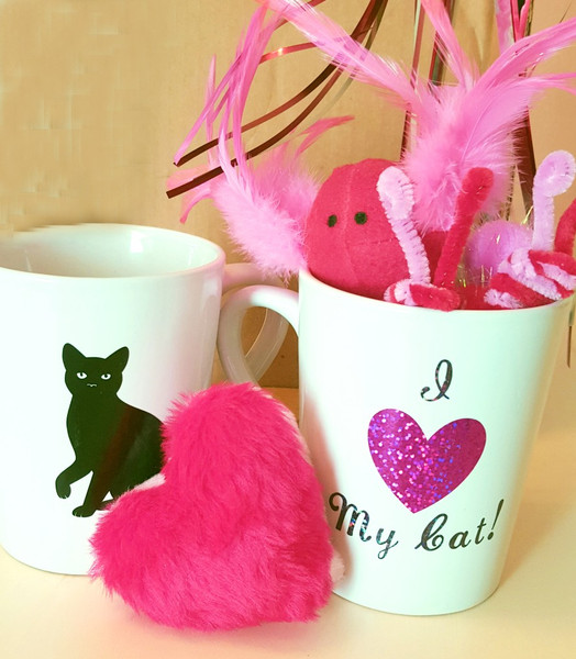 Fun Valentine coffee cup with I love my cat fully displayed on front, cat silhouette on back. Filled with red and pink fur heart, mini sparkler, pink and red glitter poms, fun catnip filled red and pink Fruppie, 2 red and pink bees, and Catnip/Chicken homemade Mouse Bite treat sampler. Lots of fun at a great price! Fun for you or as a gift!  SUPPLIES ARE LIMITED.