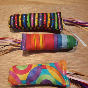 Colorful catnip filled rainbow fish. (One fish per order)