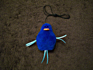 Playful catnip Blue Bird with attached elastic cord for lots of interactive fun!