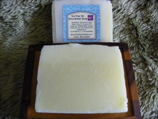 Tea Tree Oil Shea Butter Soap Made with Coconut Oil, Shea Butter, Olive Oil, Sweet Almond Oil, Castor Oil, Distilled Water, Sodium Hydroxide, Tea Tree Essential Oil, Natural Color. Weighes approx. 4 ounces. Bold and Inviting.
