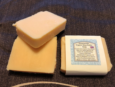 Dreamsickle Organic Shea Butter Soap This soap is made with Coconut Oil,Organic Shea Butter, Olive Oil, Sweet Almond Oil, Castor Oil, Distilled Water, Sodium Hydroxide,  Dreamsickle Fragrance Oil. Soap weighes approx 4 ounces. The Organic shea butter bars are the best soaps. Sweet Orange and Vanilla  Smells Pushup Ice Cream Pops