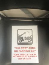 No Parking Sign with Logo of Tow Truck