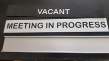 Meeting in progress door sign