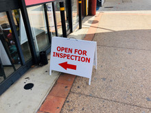 OPEN FOR INSPECTION A FRAME WITH ARROW