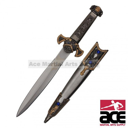 "Roman-inspired dagger. Ornately designed scabbard and handle. Gold highlights throughout scabbard, crossguard, and handle. Blue jewels on scabbard. 13"" Overall"