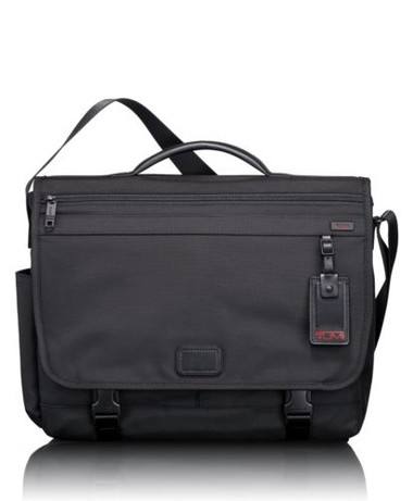 This well-appointed messenger bag is crafted out of durable ballistic nylon and built to withstand whatever comes its way. Its thoughtful design includes cleverly positioned pockets for all of your business accessories, and the main compartment fits both work essentials and your gym clothes. Open front pocket, ballistic top carry handle, gusseted zip pockets under flap.