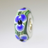 Embossed Blue Flowers On Ivory Opaque Bead