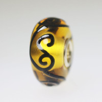 Amber Toned Glass Bead With Ornament