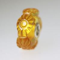 Sun Burst Carved Amber Bead
