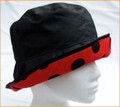 Black Wax Hat with Black Spots on Red Brim