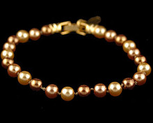 Light gold, bronze and taupe color Pearl bracelet.  (Brown)