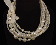 Multi Size and Strand Cream Luster Pearls with Cream Ribbon