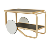 Frame: birch, clear lacquer Wheels: MDF, white lacquer Top and shelf surface: linoleum, black