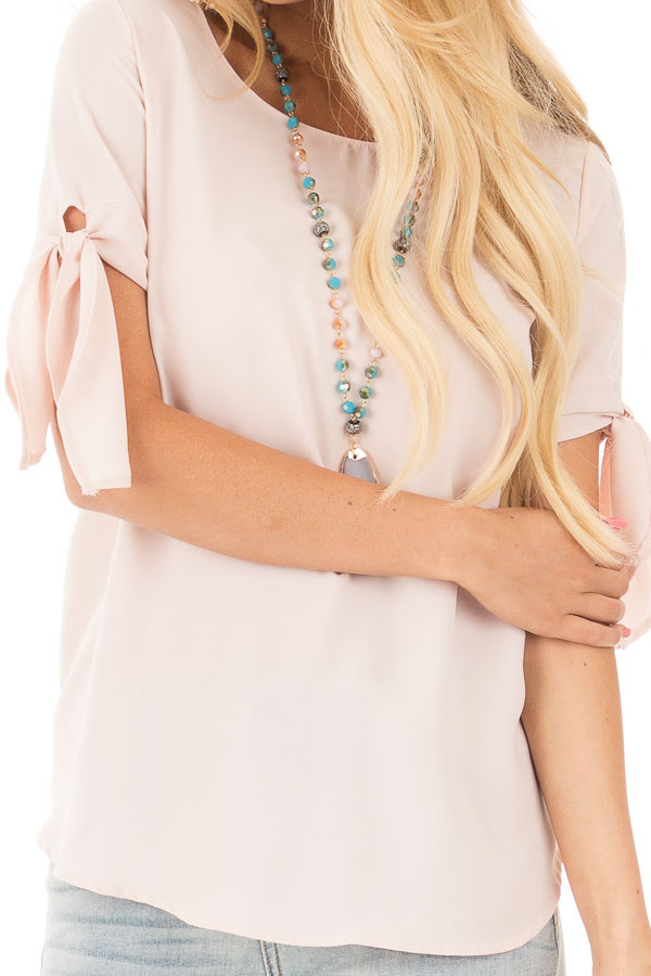 Blush Chiffon Round Neck Top with Tie Sleeve Detail detail