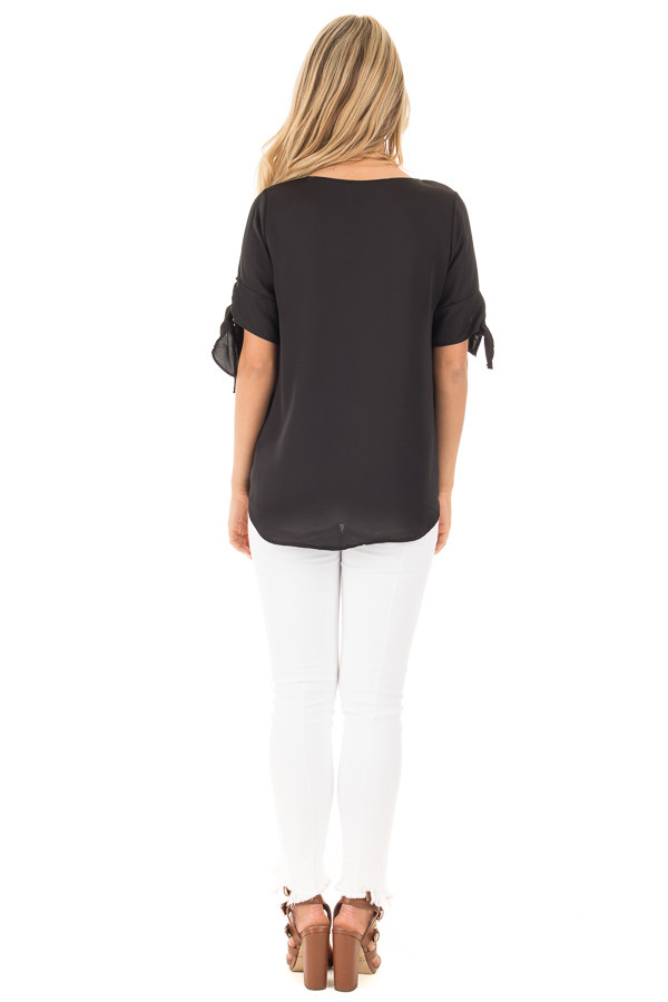 Black Short Sleeve Top with Tie Details on Sleeves back full body