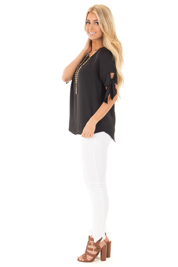 Black Short Sleeve Top with Tie Details on Sleeves side full body