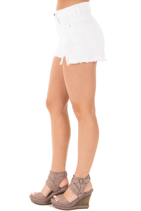 White High Rise Distressed Shorts with Unfinished Hem side right leg