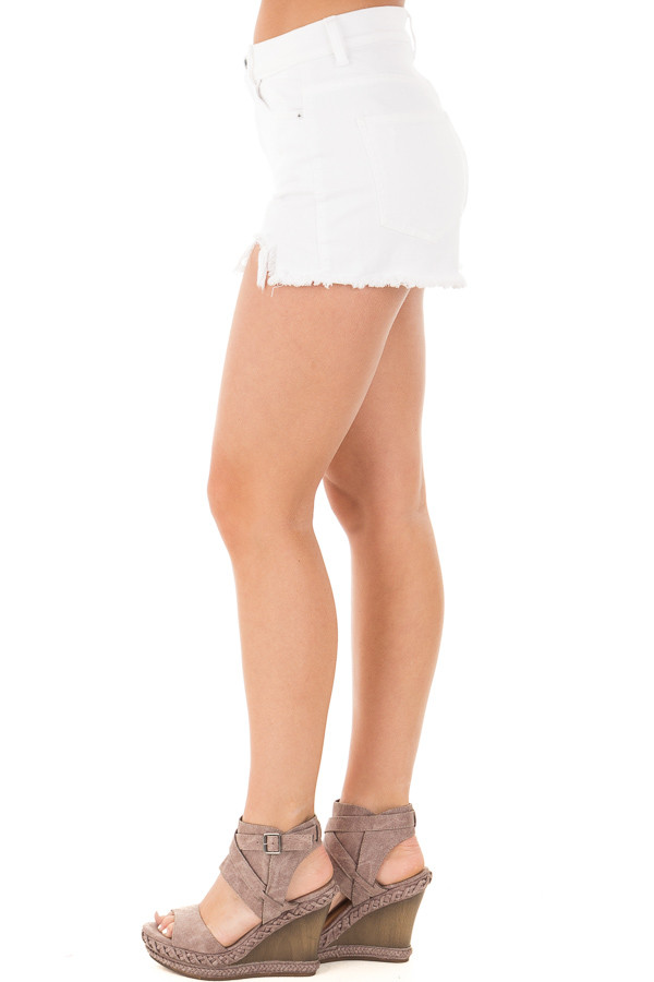 White High Rise Distressed Shorts with Unfinished Hem side left leg