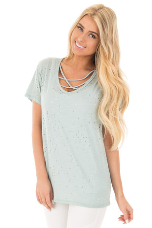 Sage Distressed Loose Fit Tee with Strappy V Neck Detail front close up