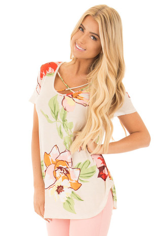 Ivory Floral Criss Cross V Neck Top with Rounded Hemline front close up