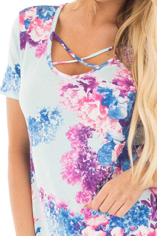 Baby Blue Criss Cross Neckline Tee with Bright Floral Print detail