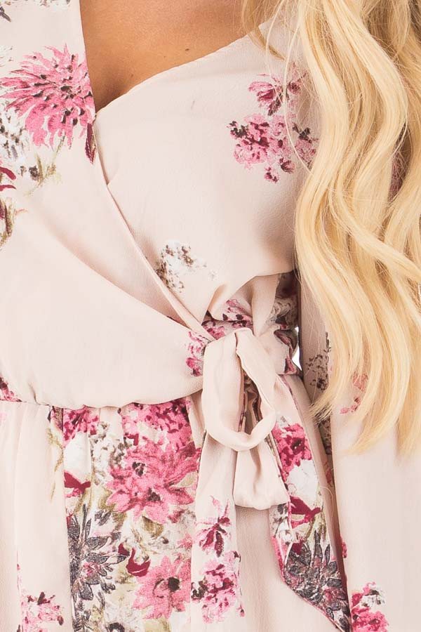 Light Blush Wrap Style Romper with Rose Floral Print detail