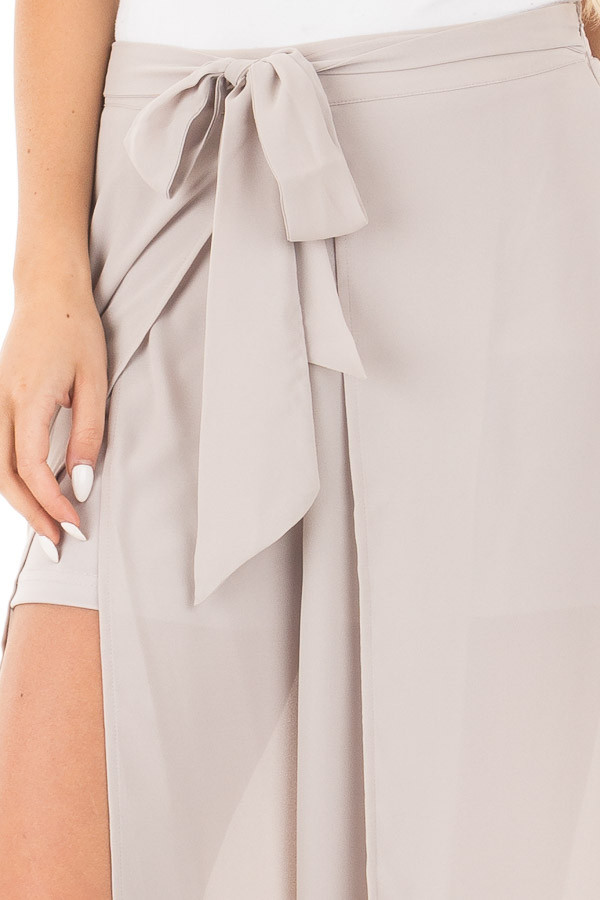Silver High Waist Flowy Pants with Center Slit and Waist Tie detail