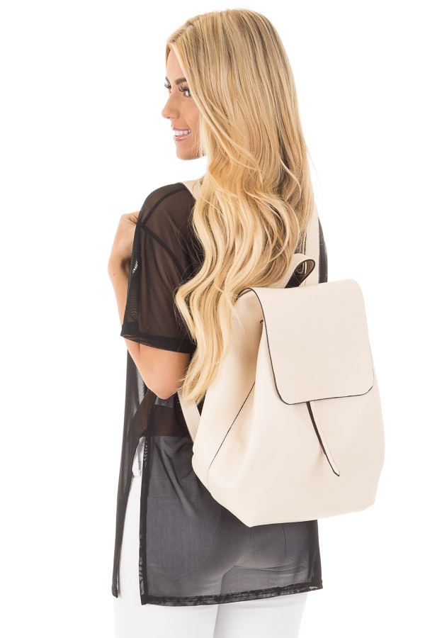 Cream Flap Over Faux Leather Backpack back side close up