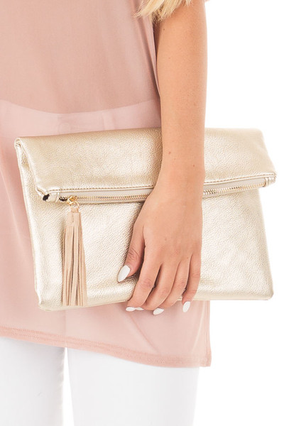 Gold Oversized Fold Over Clutch with Suede Tassel Detail close