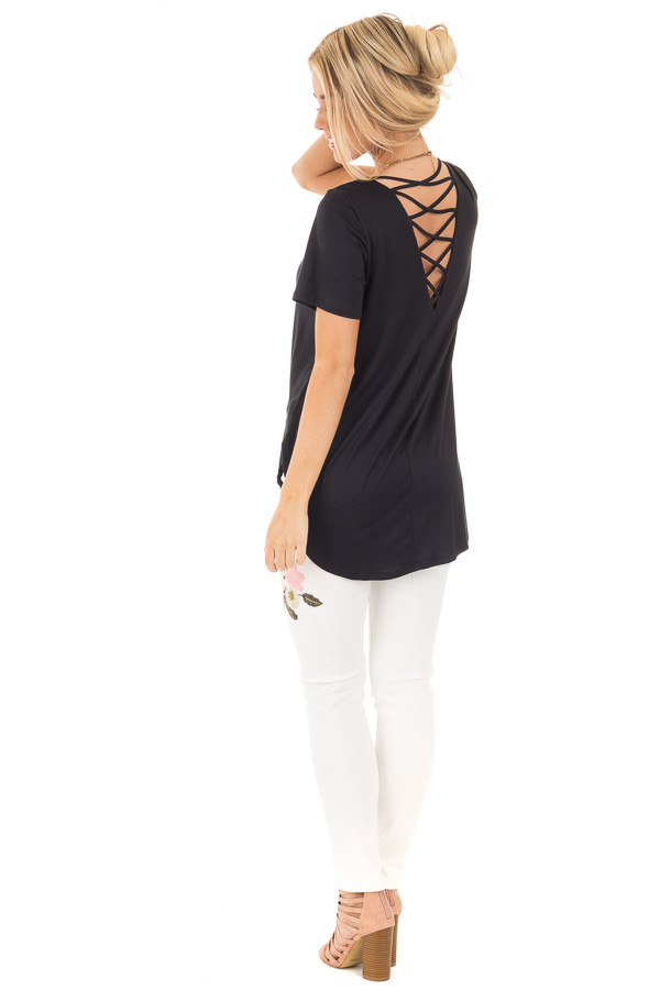 Black Short Sleeve Top with Criss Cross Back and Rounded Hem back side full body