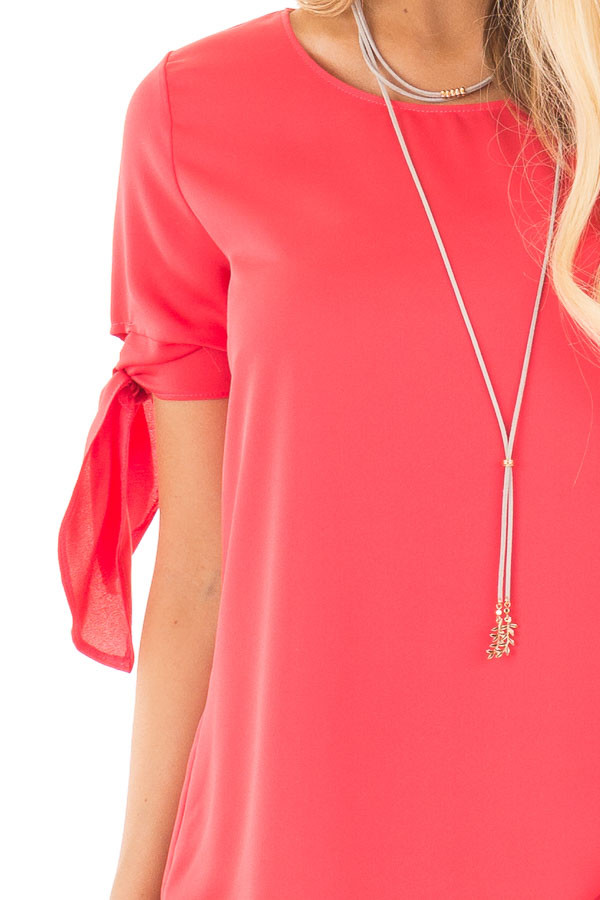 Coral Chiffon Round Neck Top with Tie Sleeve Detail detail