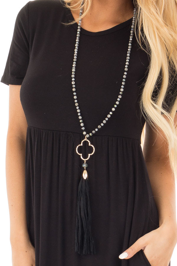 Black Marble Beaded Necklace with Clover Pendent and Tassel close up