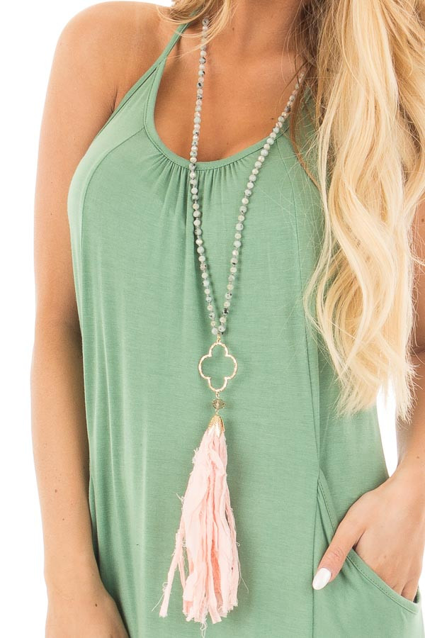 Kiwi Stone Beaded Necklace with Clover Pendent and Tassel close up