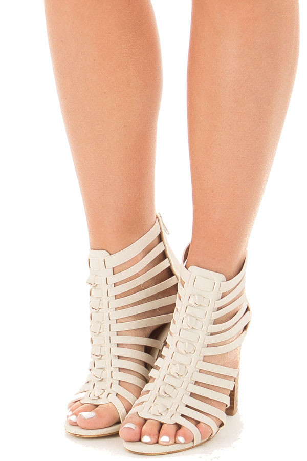 Off White Faux Leather Caged Heel Bootie with Knot Detail front view