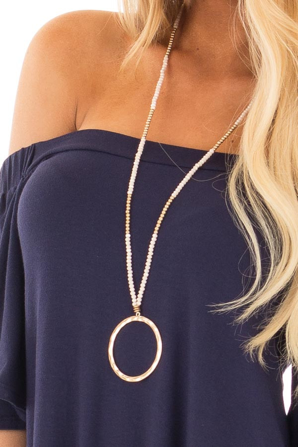 Gold and Blush Beaded Necklace with Circle Pendant close