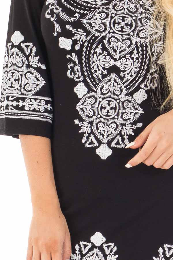 Black 3/4 Sleeve Dress with White Embroidered Detail detail