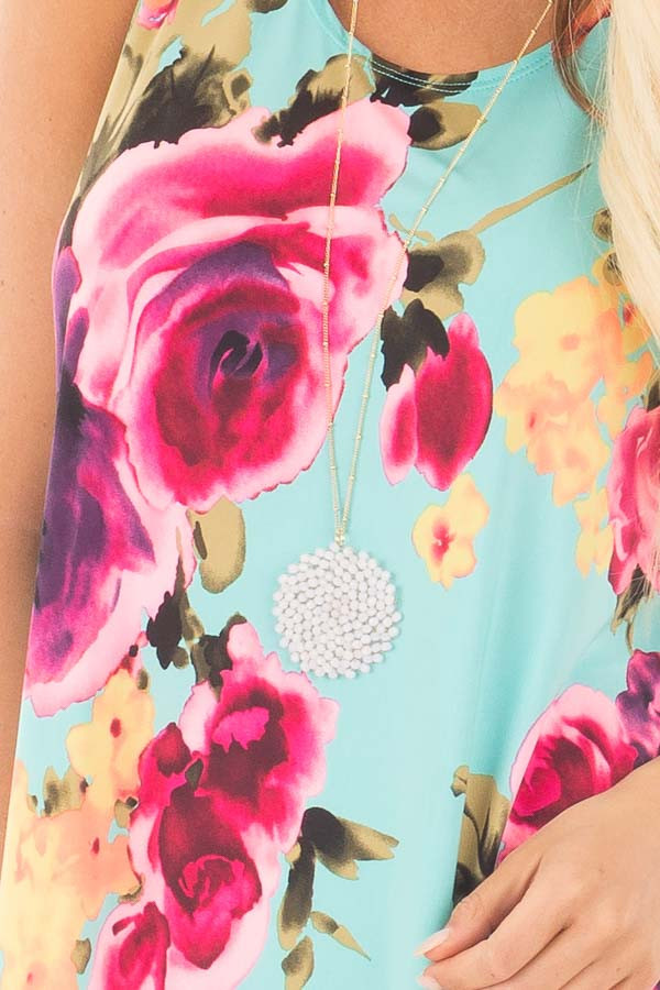 Aqua Slinky Sleeveless Dress with Multicolor Floral Print detail