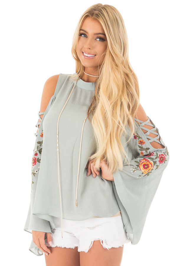 Dusty Blue Blouse with Embroidered Criss Cross Bell Sleeves front close up