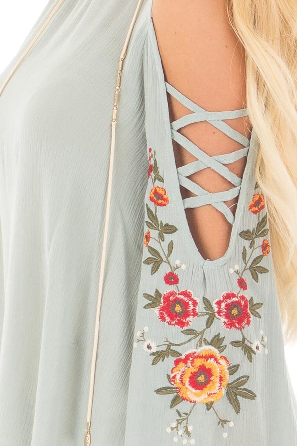 Dusty Blue Blouse with Embroidered Criss Cross Bell Sleeves detail