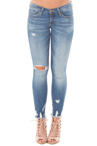 Medium Wash Cropped Skinny Jeans with Distressed Details front view