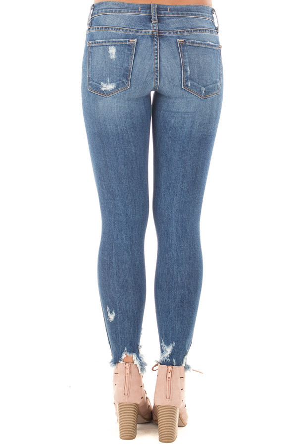 Medium Wash Cropped Skinny Jeans with Distressed Details back view