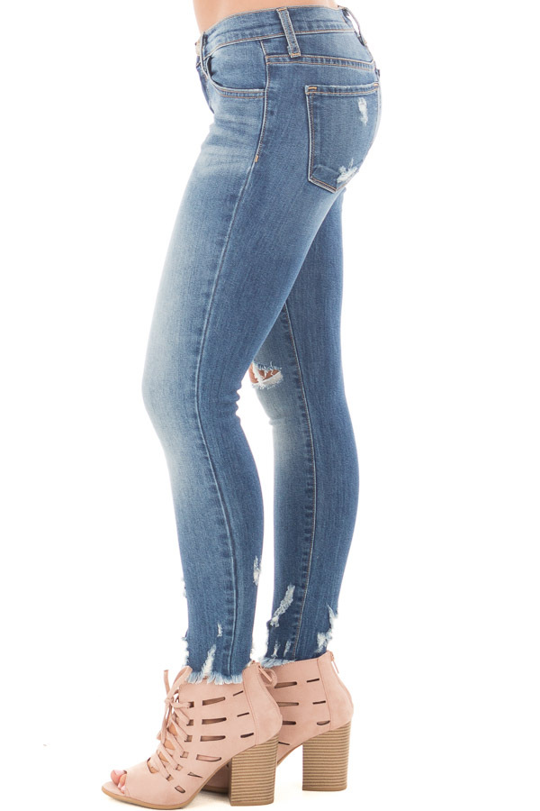 Medium Wash Cropped Skinny Jeans with Distressed Details side left leg